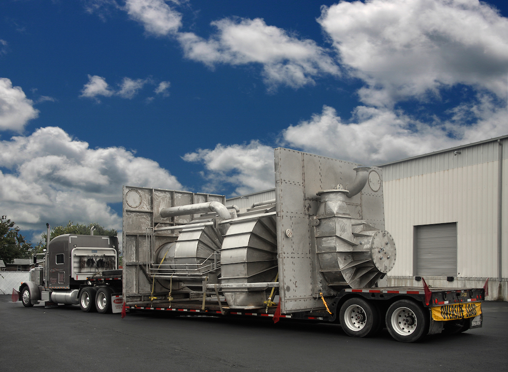 Piping spools with custom heat exchangers and other large custom equipment like can be transported by truck.
